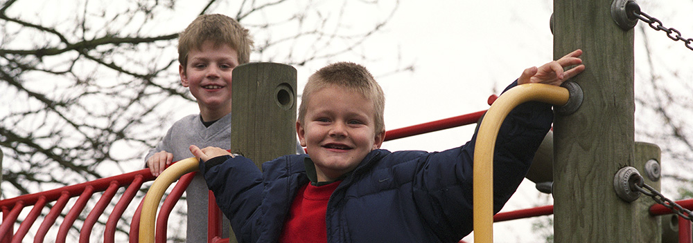 Boys on a climbing frame